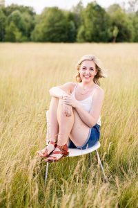 Abby legs up on chair
